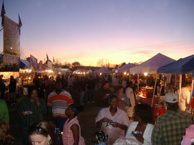 The sun sets on a wildly successful Saturday at the 4th Pork in the Park rib festival, April 21, 2007.