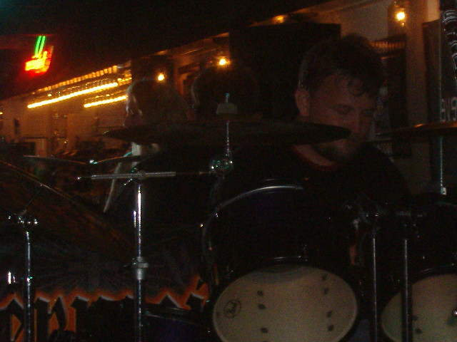 Lynn hammering on his drums. It's hard to get his pic in the back.